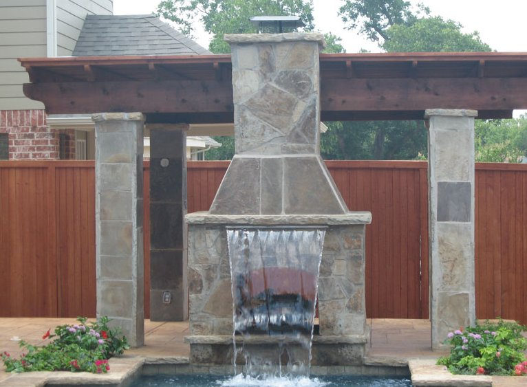 waterfall outdoor fireplace- Dallas TX    www.grasshopperslandscapingllc.com
