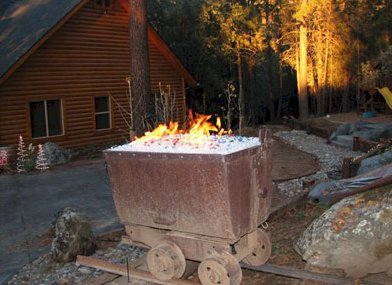 fireglass firepit feature mine car Dallas TX  www.grasshopperslandscapingllc.com